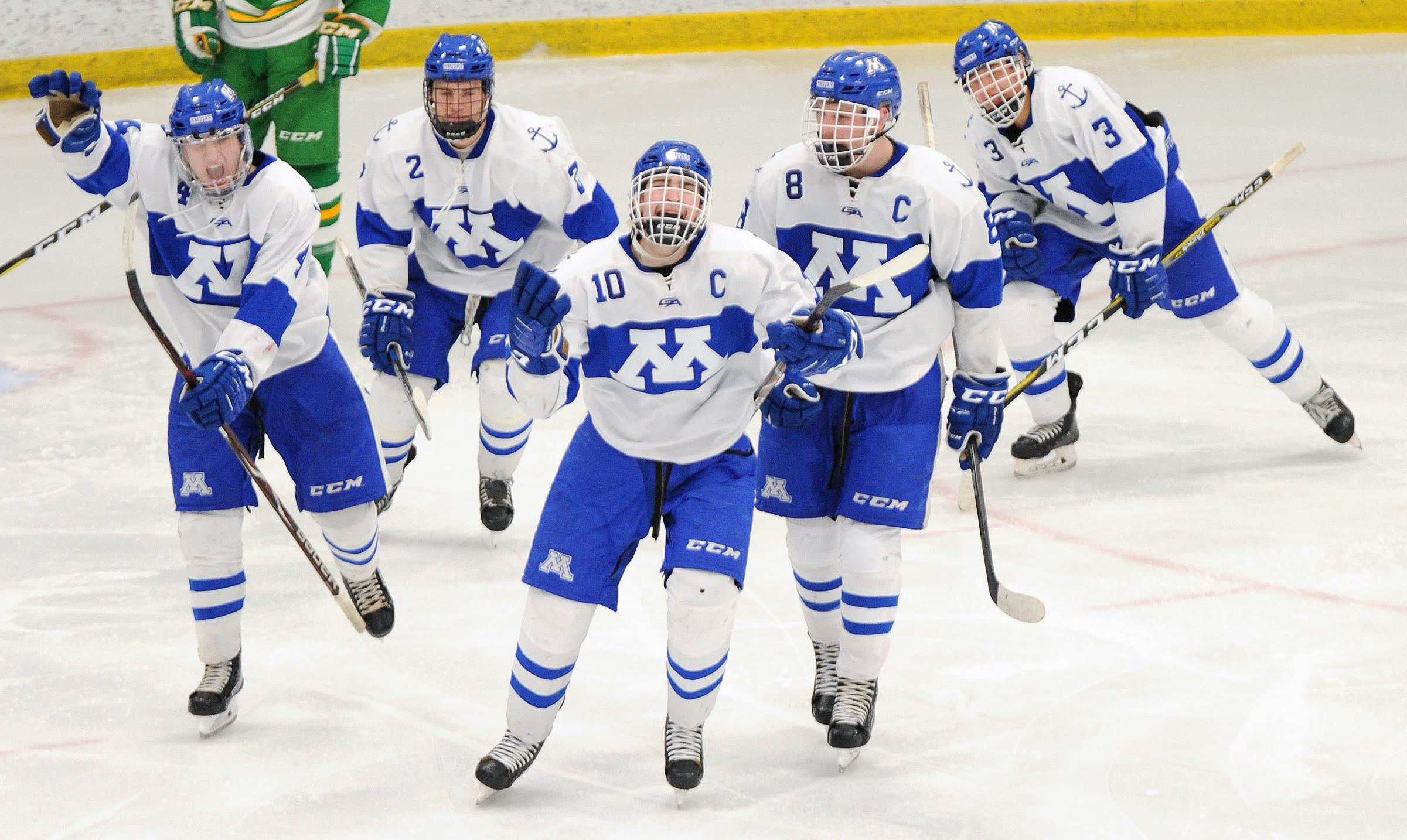 Minnetonka's Joe Molenaar (No. 10) leads the Skippers' celebration after scoring a third-period goal on Saturday afternoon. No. 2 Minnetonka beat No. 1 Edina 5-3. Photo by Loren Nelson, legacyhockeyphotography.net