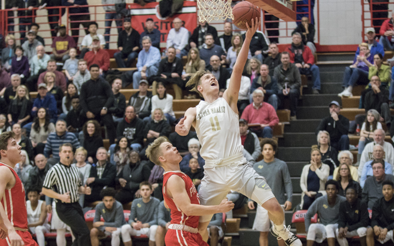 Apple Valley senior Luke Martens soars in on the layup against Lakeville North Tuesday night. The Eagles avenged their loss earlier this season to the Panthers with a 63-50 victory. Photo by Jeff Lawler SportsEngine