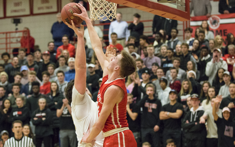 Lakeville North's Tyler Wahl gets the clean block Tuesday night against Apple Valley. The Panthers fell to the Eagles 63-50. Photo by Jeff Lawler, SportsEngine