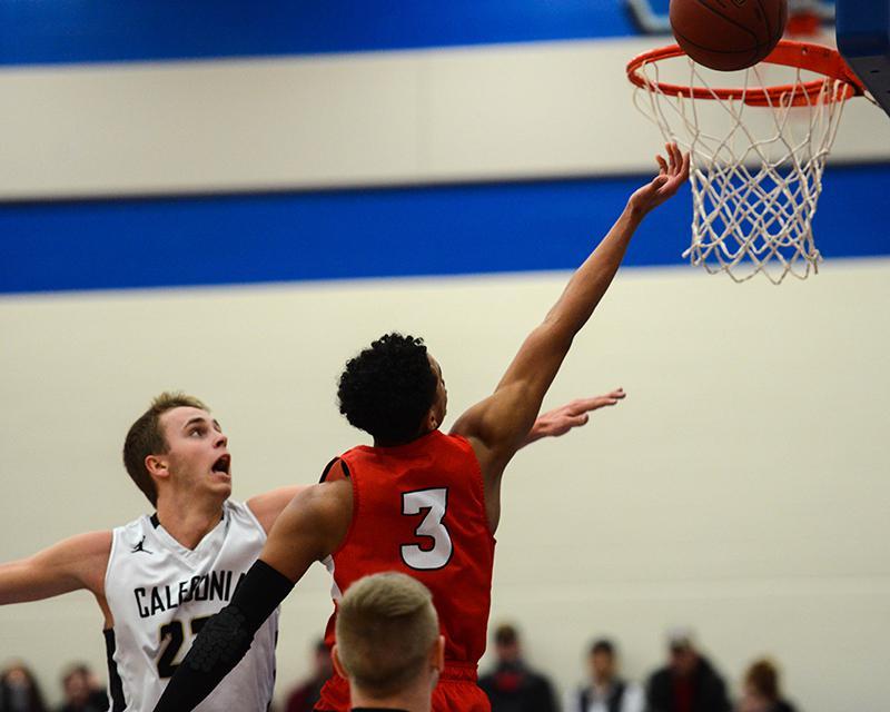 Minnehaha Academy sophomore guard Terry Lockett springs for a layup against Caledonia. Photo by Carter Jones, SportsEngine