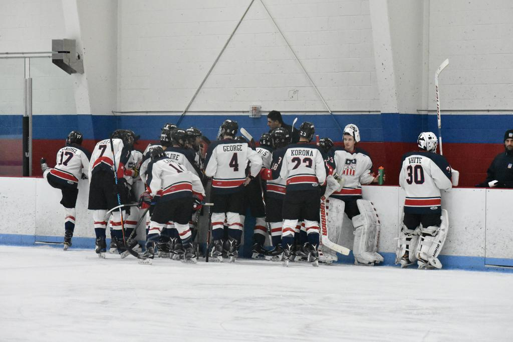 The 16U Pics gather at their bench.