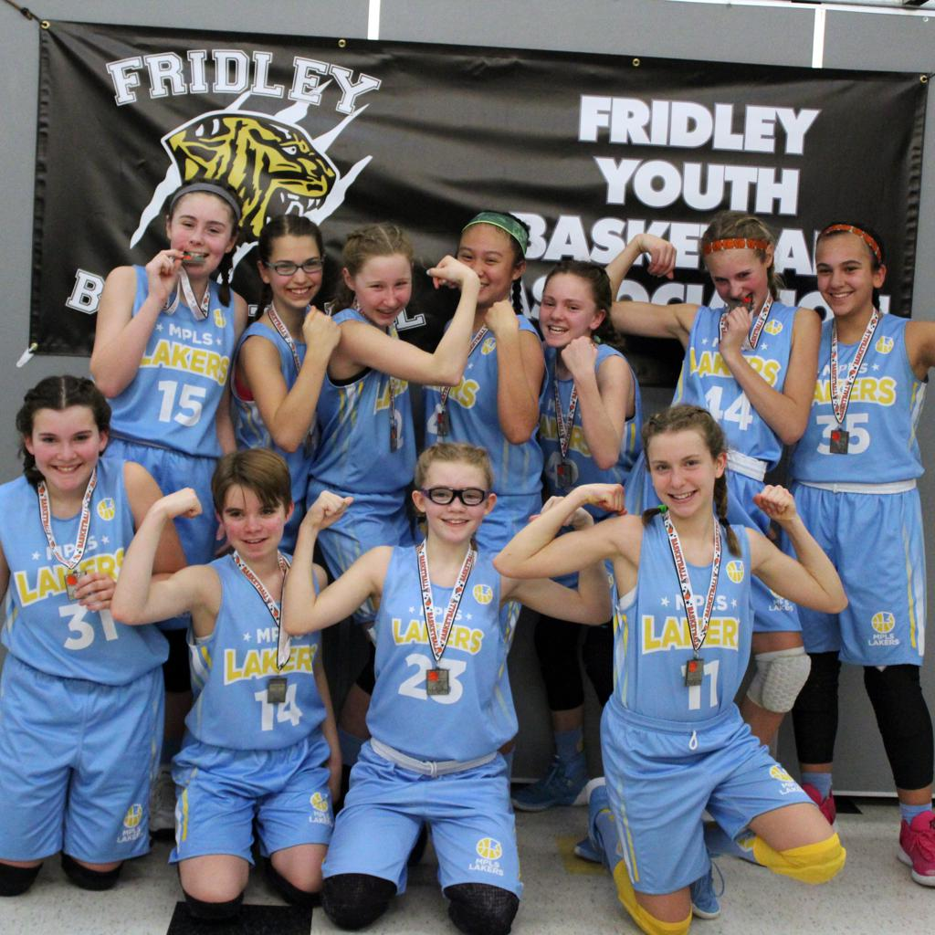Girls 7th Grade Blue showing their strength
