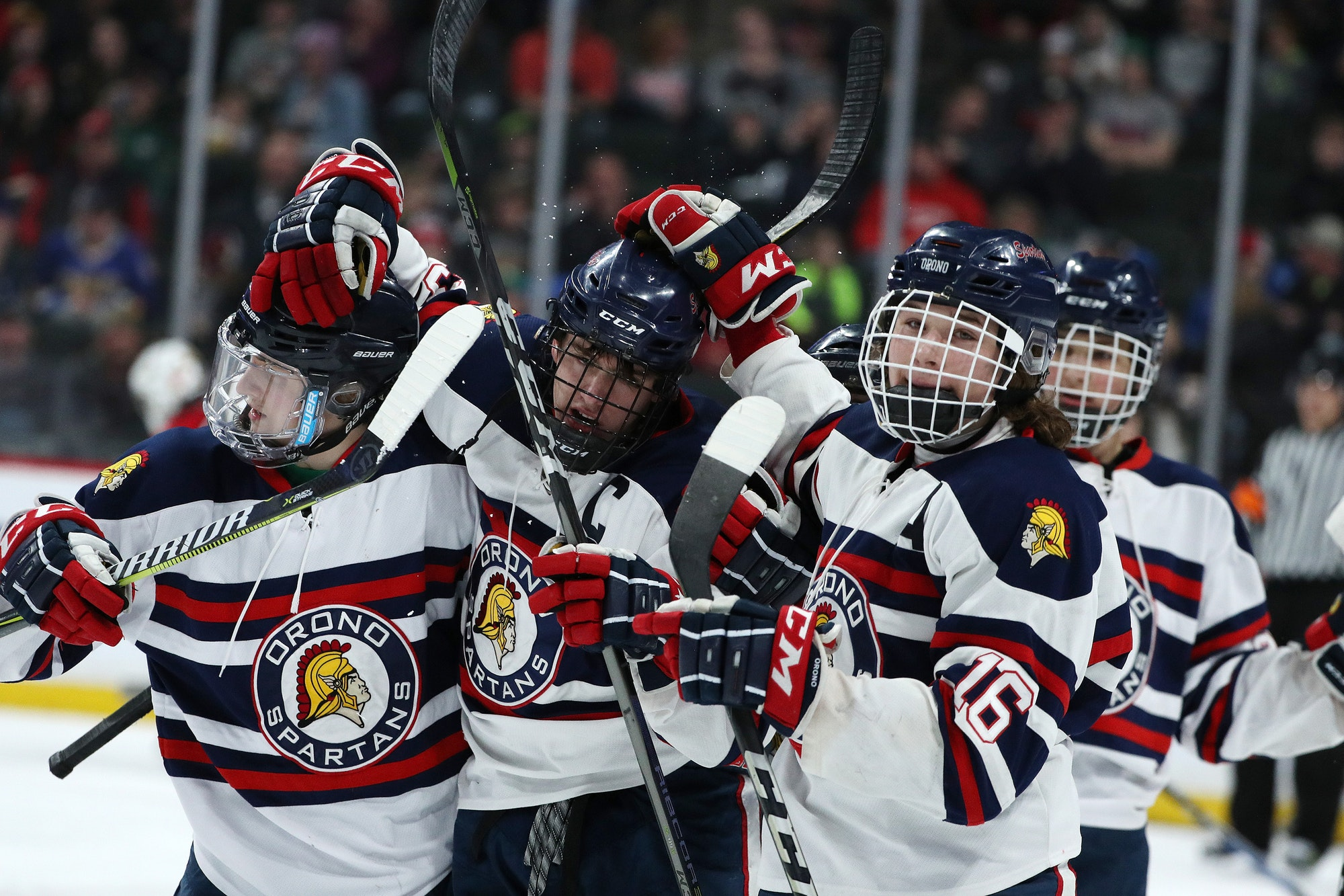 Orono forward Thomas Walker (23) celebrated with his teammates after scoring in the first period. Star Tribune photo by Anthony Souffle