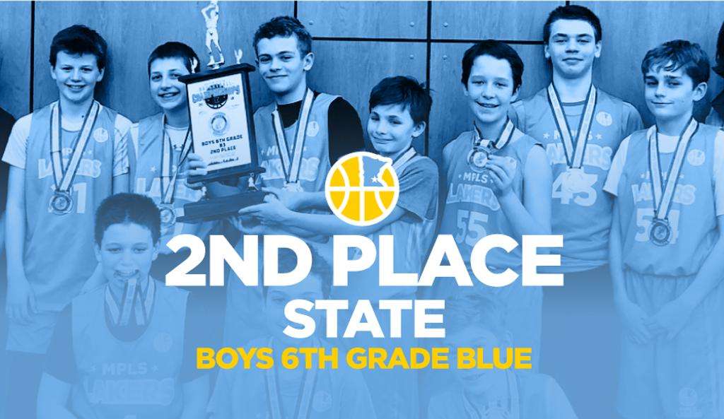 Boys 6th Grade Blue with their medals and big trophy