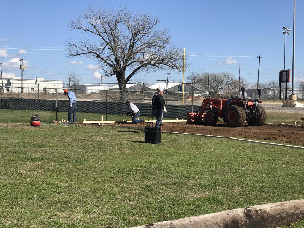 Softball batting cage being built