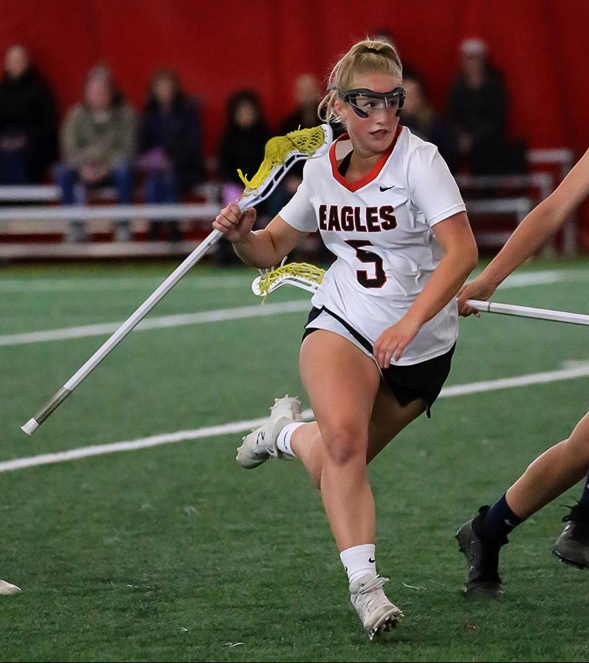 Maggie Brown (5) carries the ball past defender Leah Hodgins. Brown scored five goals, helping lead Eden Prairie to a 16-9 win over Chanhassen Photo by Cheryl Myers, SportsEngine