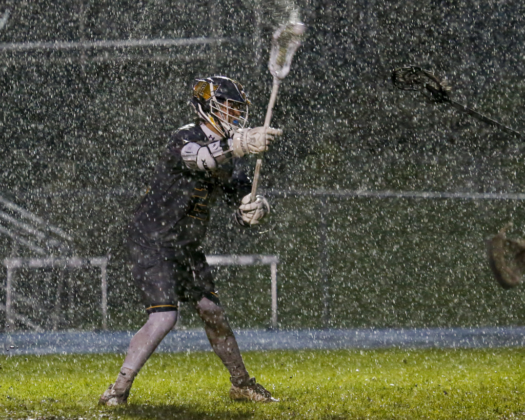 In the driving rain, Prior Lake's Nathan Whittier fires a shot for his third goal of the game against Eagan. The Lakers defeated the Wildcats 11-7. Photo by Jeff Lawler, SportsEngine