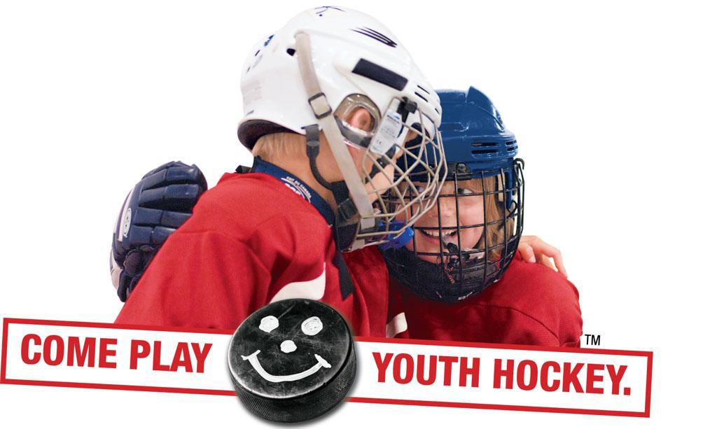 2 small hockey players smiling
