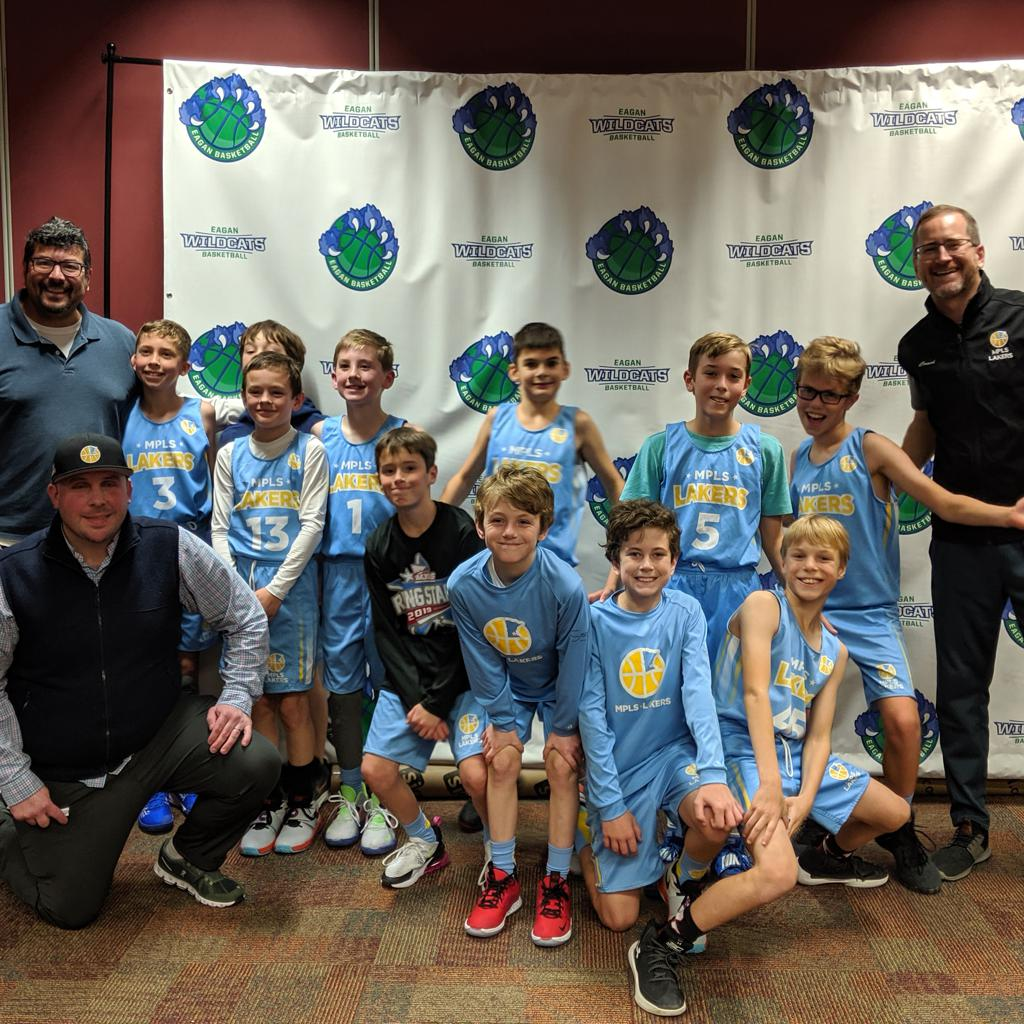 Minneapolis Lakers Boys 5th Grade White pose with their Hats after becoming the Champions at the Eagan Run N Gun Classic tournament in Eagan, MN