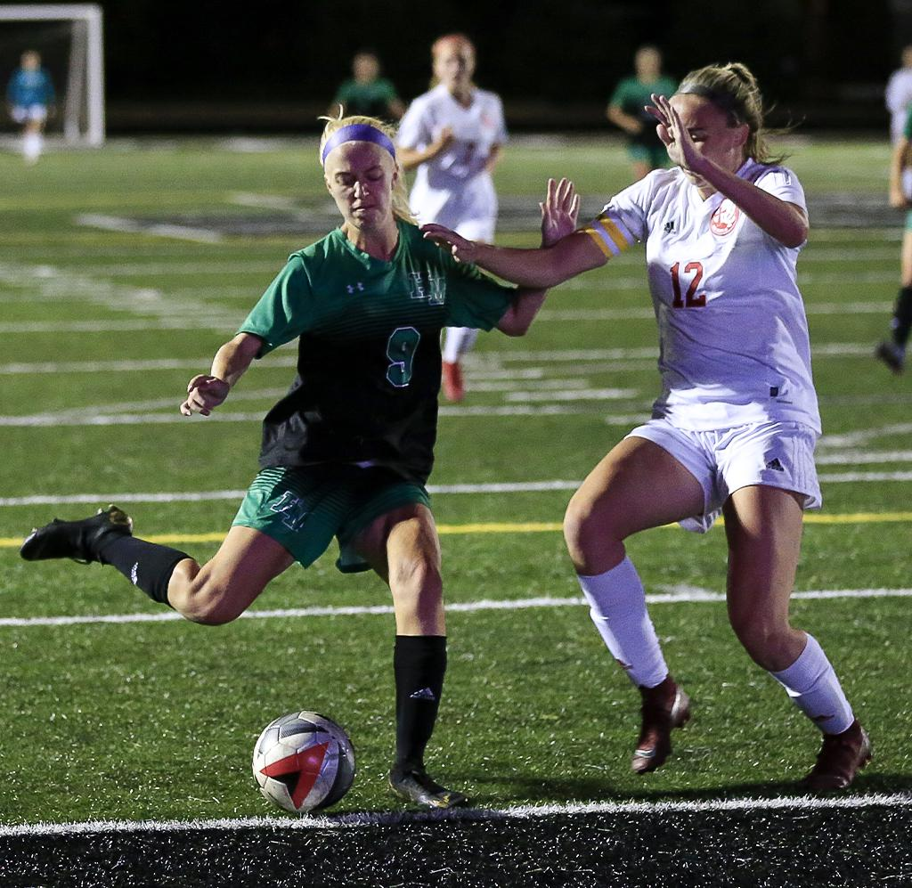 Hill-Murray's Claire Cater (9) led the game in scoring with two goals. The Pioneers and Blazers ended in a 2-2 tie at Hill-Murray on Tuesday night. Photo by Cheryl Myers, SportsEngine