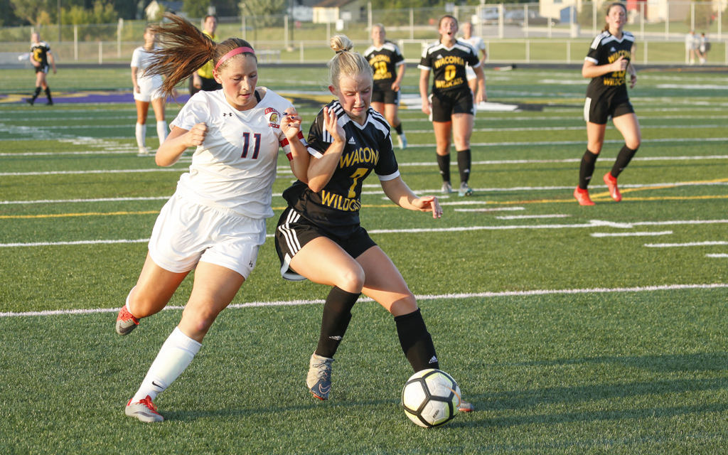 Orono's Megan Marzolf (11) and Waconia's Jenna Fawcett (7) battle for control of the ball late in Tuesday's match in Waconia. The Spartans and Wildcats played to a 1-1 draw. Photo by Jeff Lawler, SportsEngine