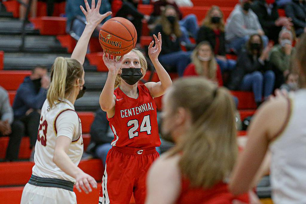 Sophomore Megan Stacy (24) puts up the first of her two three-point baskets late in regulation that gave Centennial its first lead of the game. Photo by Mark Hvidsten, SportsEngine