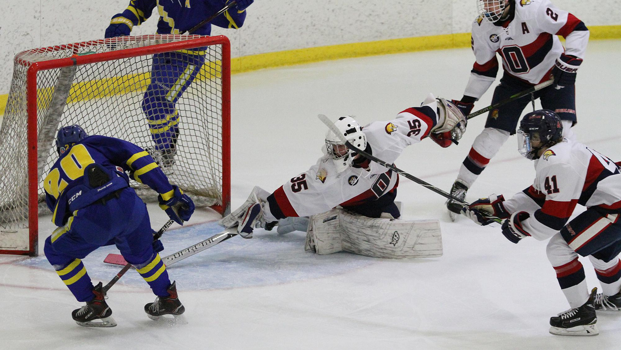 St. Cloud Cathedral forward Jack Smith buries a power-play goal in the first period of Saturday's game in Orono. Smith finished with two goals and six points in the Crusaders' 9-6 win over the Spartans. Photo by Drew Herron, SportsEngine