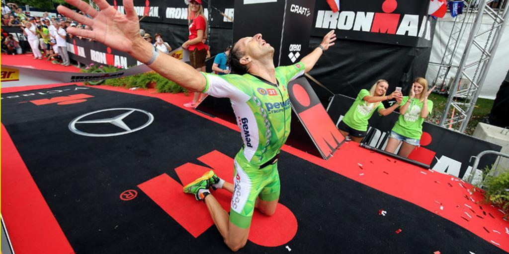 An athlete celebrating finishing