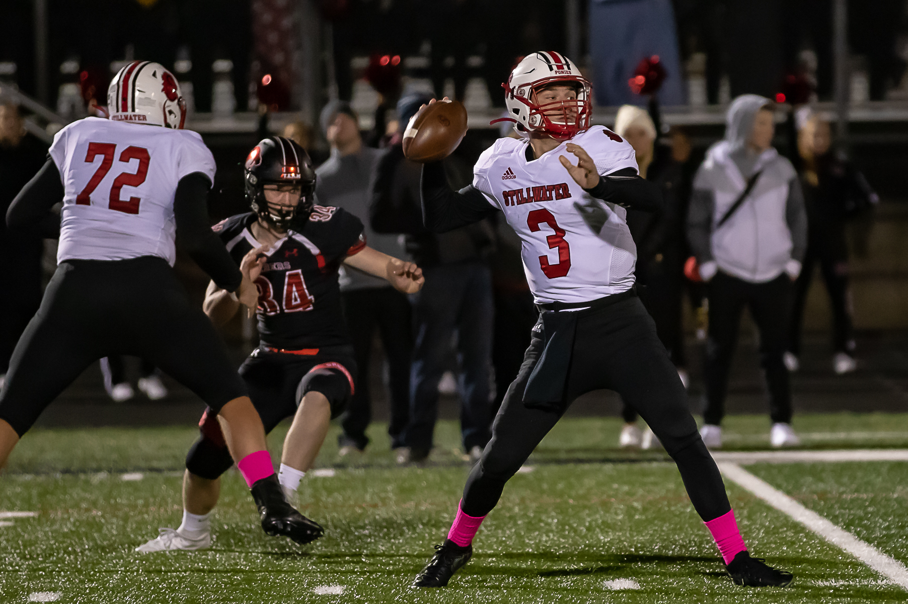 Stillwater junior quarterback Casey Venske (3) attempts a pass against host Shakopee Friday night. Venske completed the game with 95 yards passing. Photo by Gary Mukai, SportsEngine