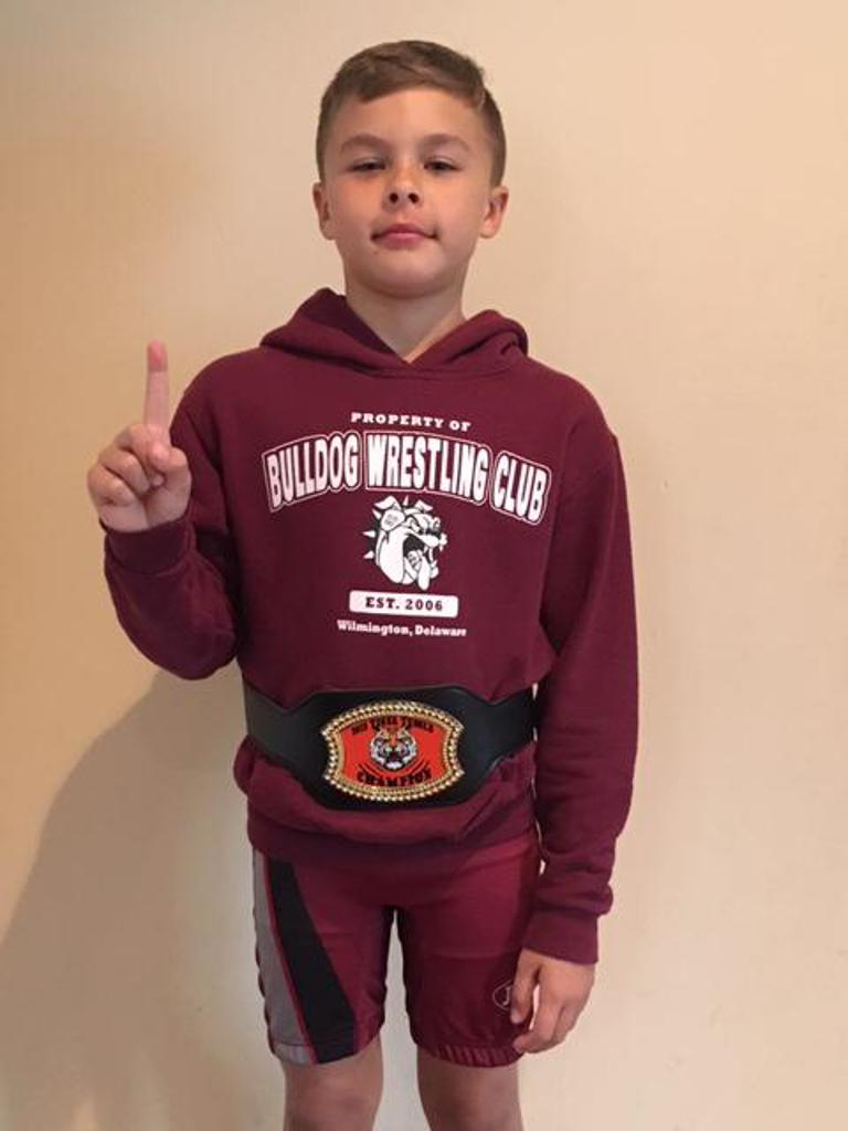 Brayden McLaughlin wearing his Tiger Tussle Champion belt