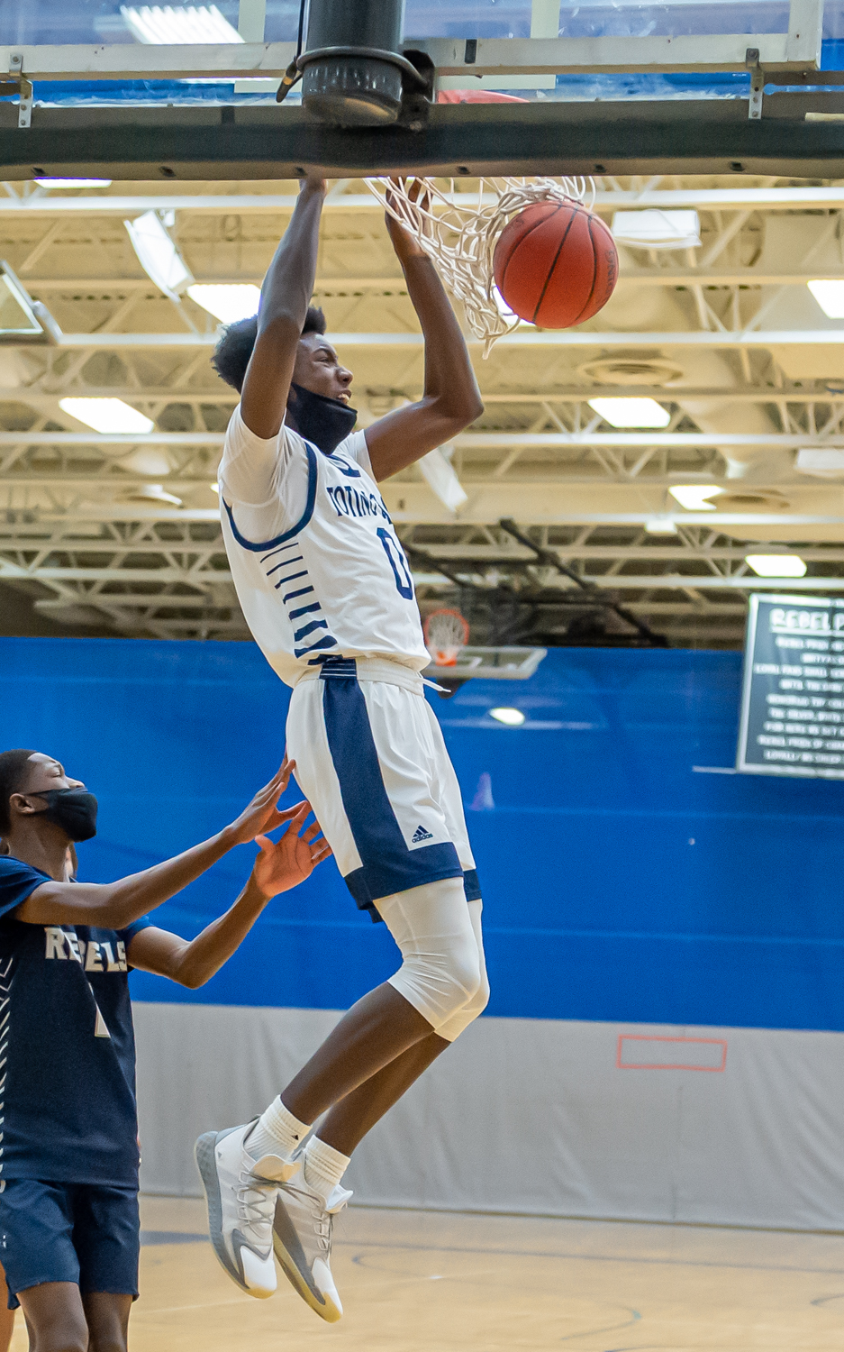 The Eagles' Demarion Watson goes up for a slam dunk in the first half Thursday. The Eagles fell to the rival Rebels 75-65 at Champlin Park. Photo by Earl J. Ebensteiner, SportsEngine