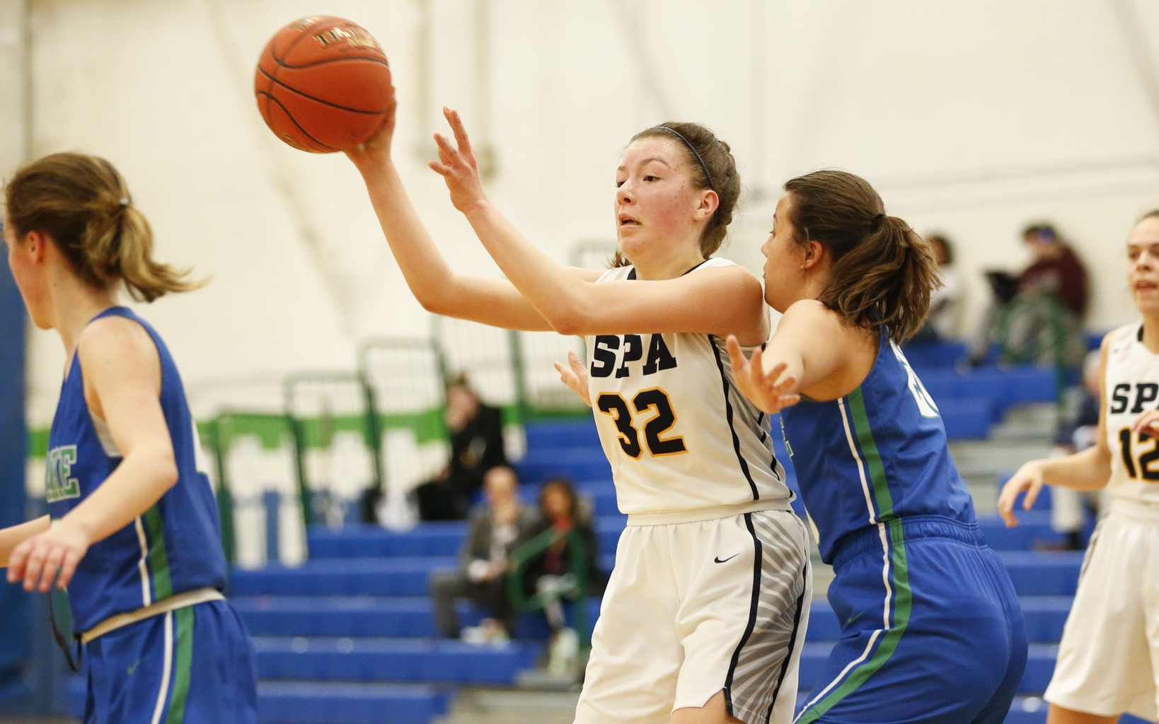 St. Paul Academy's Pilar Saavedra-Weis (32) passes the ball outside after pulling down a rebound against Blake Thursday night. Saavedra-Weis had 12 points and 14 rebounds in the Spartans 68-39 loss to the Bears. Photo by Jeff Lawler, SportsEngine