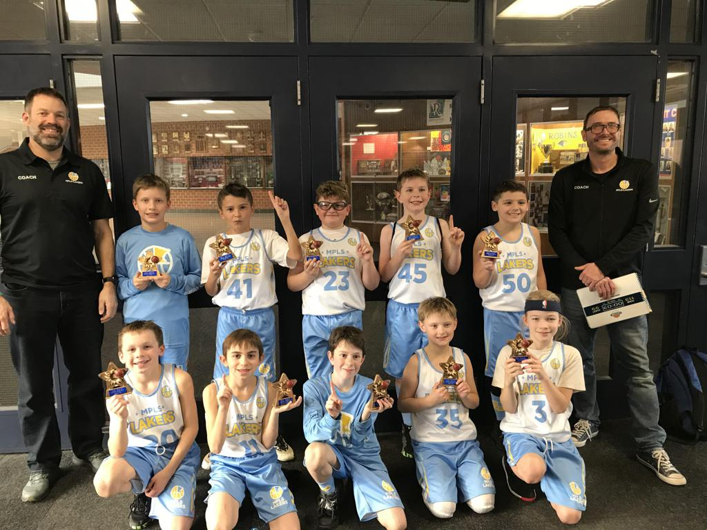 Minneapolis Lakers Boys 4th Grade Blue pose with their Trophies after becoming the Champions at the Armstrong Winter Shootout tournament in Robbinsdale, MN
