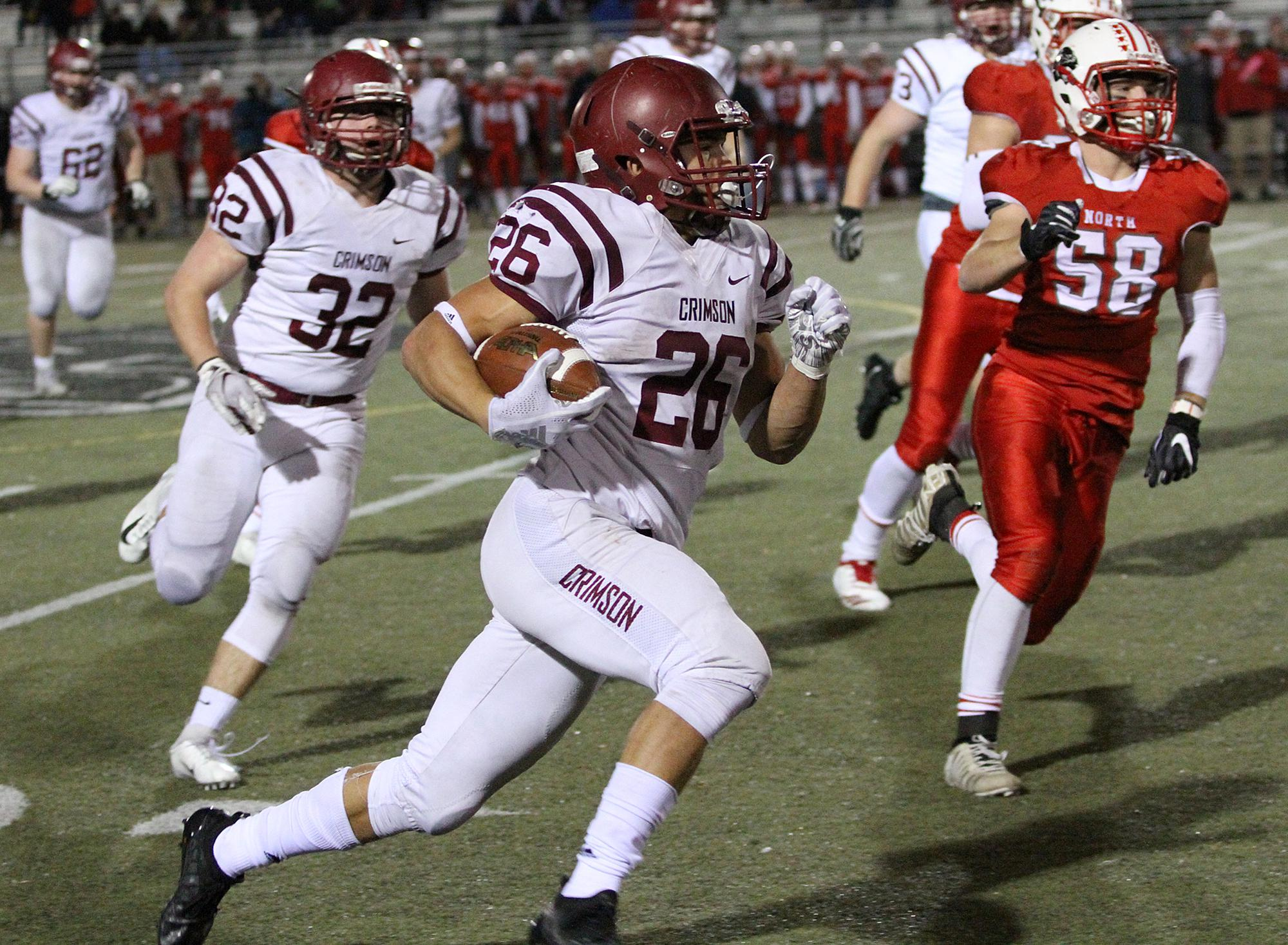 Maple Grove running back Evan Hull had 26 carries for 83 yards in the Crimson's 21-13 loss at Lakeville North Friday night. Photo by Drew Herron, SportsEngine
