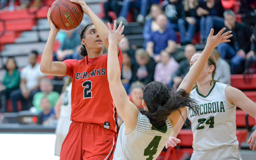 The Redhawks' Nevaeh Galloway (2) powers her way in for two points. Nevaeh scored 16 points, helping Minnehaha Academy win 74-57 over Concordia Academy. Photo by Earl J. Ebensteiner, SportsEngine