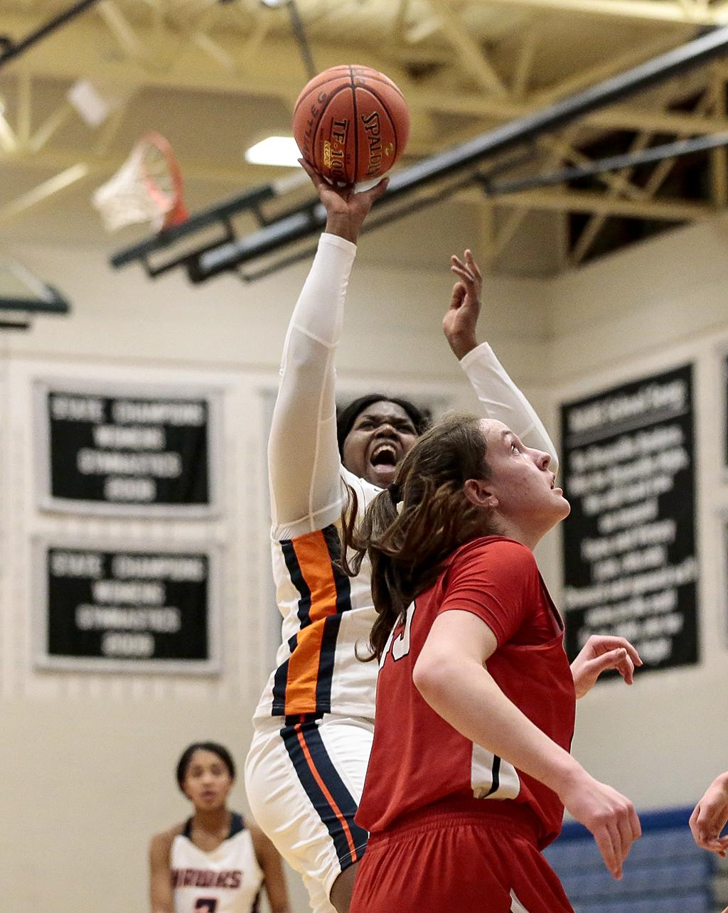 Robbinsdale Cooper's Meme Wheeler (21) shoots over the the head of Centennial's Jenna Guyer (45). Wheeler and teammate Jayla Reliford each scored a team-high 14 points. Photo by Cheryl A. Myers, SportsEngine