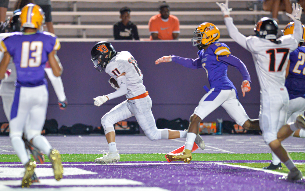 White Bear Lake's Nate Laroache takes the ball into the end zone, scoring the Bears' second touchdown of the night. The Bears lost to the Raiders 28-13 at the University of St. Thomas. Photo by Earl J. Ebensteiner, SportsEngine