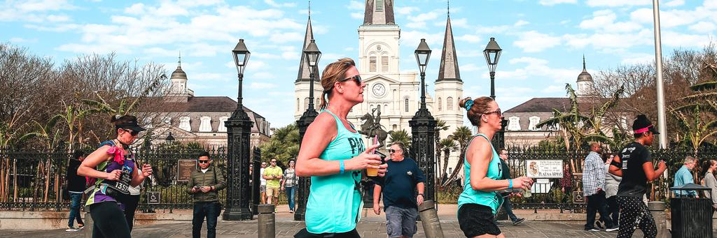 Runners in front of Jackson Square