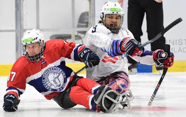 Ralph DeQuebec (right) joined the U.S. National Sled Hockey Team after serving with the Marines as a bomb technician in Afghanistan, where he suffered a near-fatal accident that ended his military career. Photo courtesy of USA