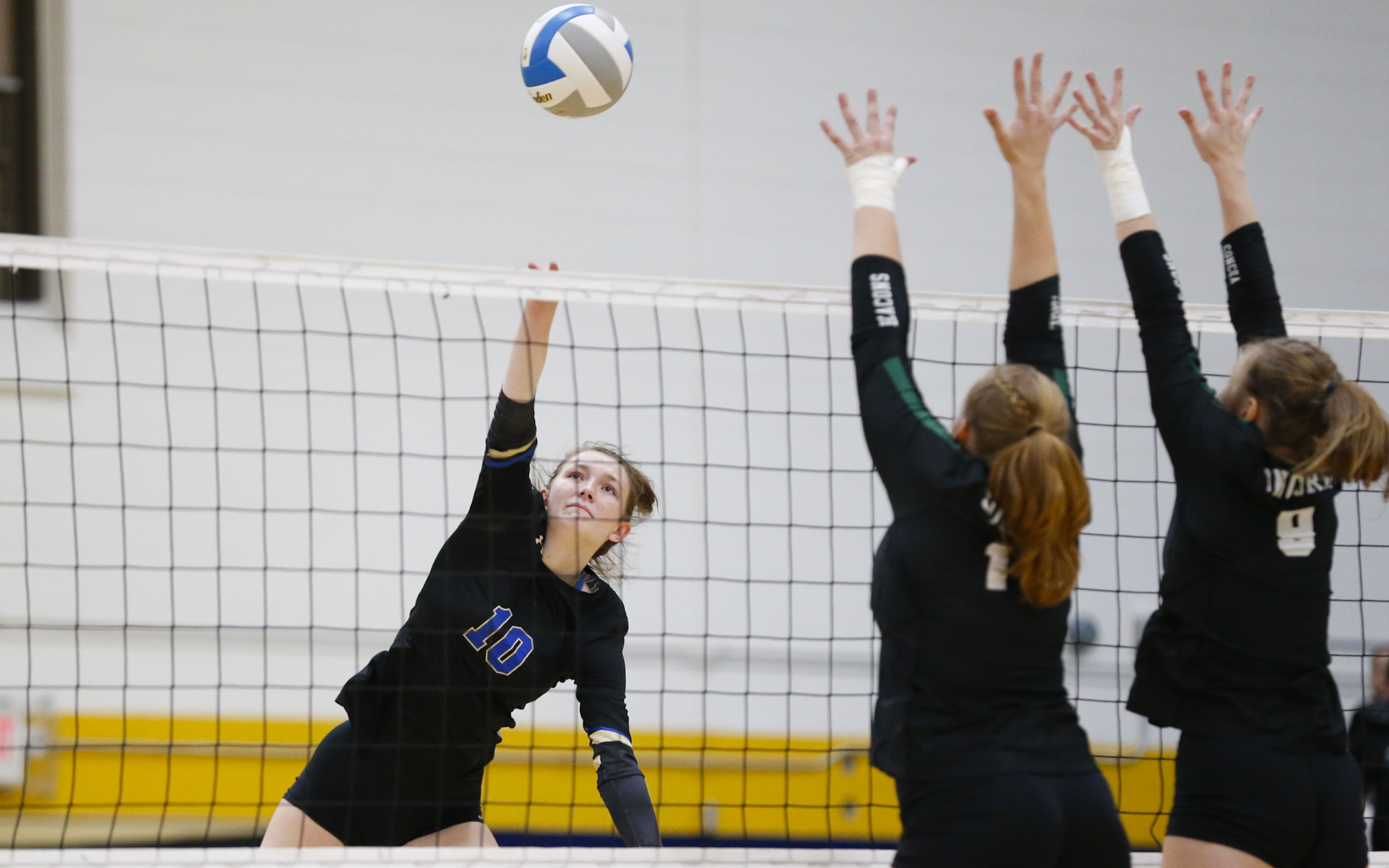 Holy Angels senior Lauren Jasper (10) taps a shot over the outstretched arms of two Concordia Academy blockers. The Stars fell 3-0 to the Beacons in the Class 2A, Section 4 final. Photo by Jeff Lawler, SportsEngine