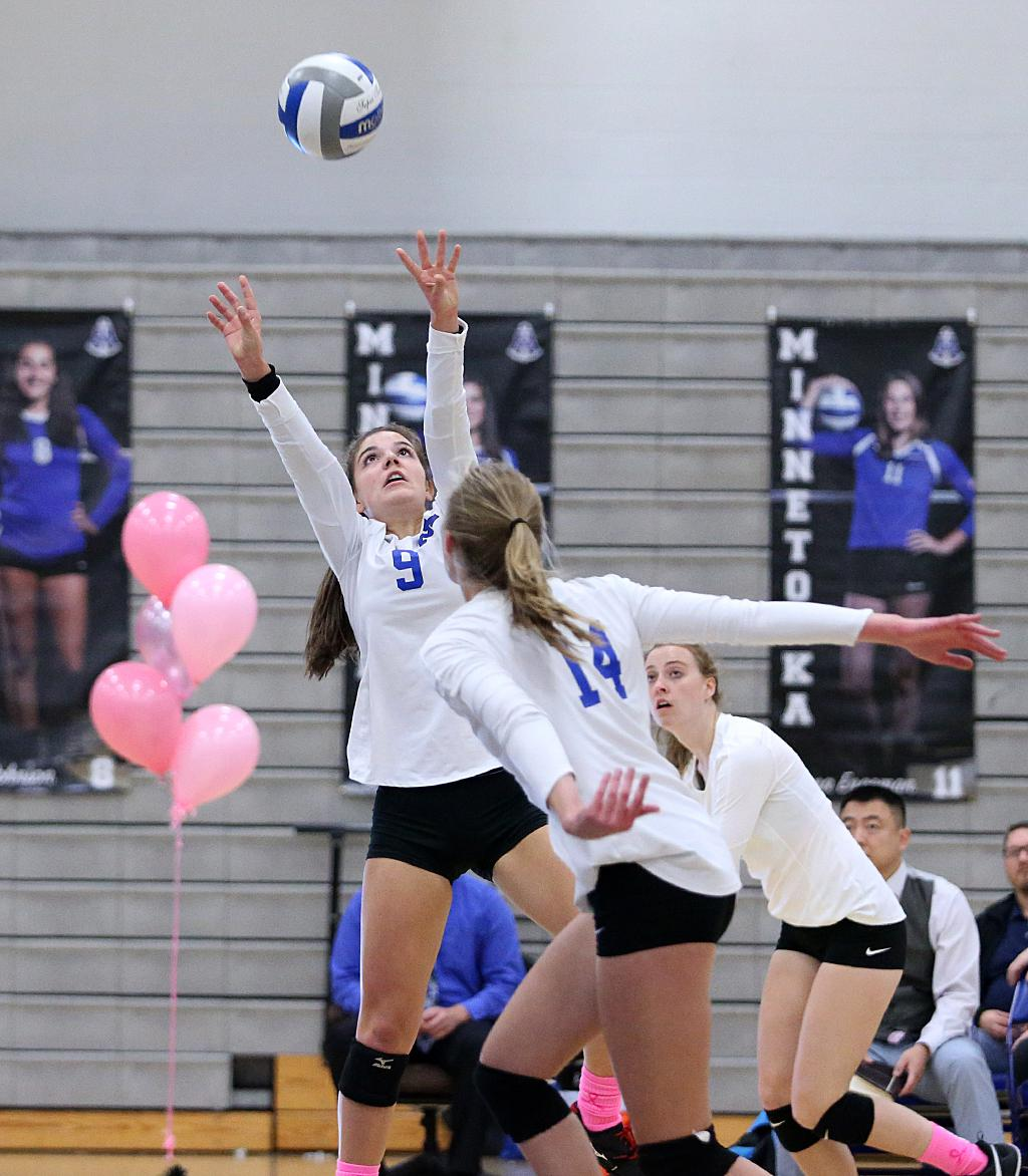 Skipper Dresden Pass (9) sets up Kali Engeman (14) for the kill. Minnetonka took down Lake Conference rival Wayzata in three sets, 25-12, 26-24 and 25-18 on Tuesday night. Photo by Cheryl Myers, SportsEngine