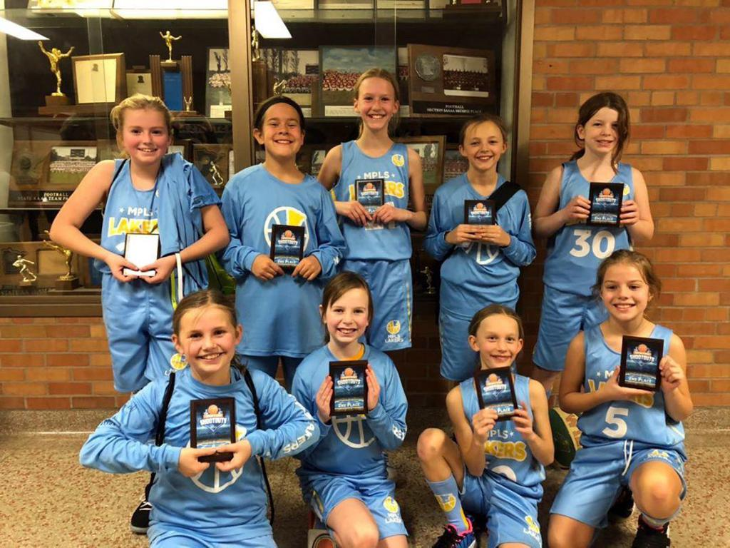 Minneapolis Lakers Girls 5th Grade Blue pose with their trophies after earning 2nd place at the MYAS Richfield Winter Shootout tournament in Richfield, MN