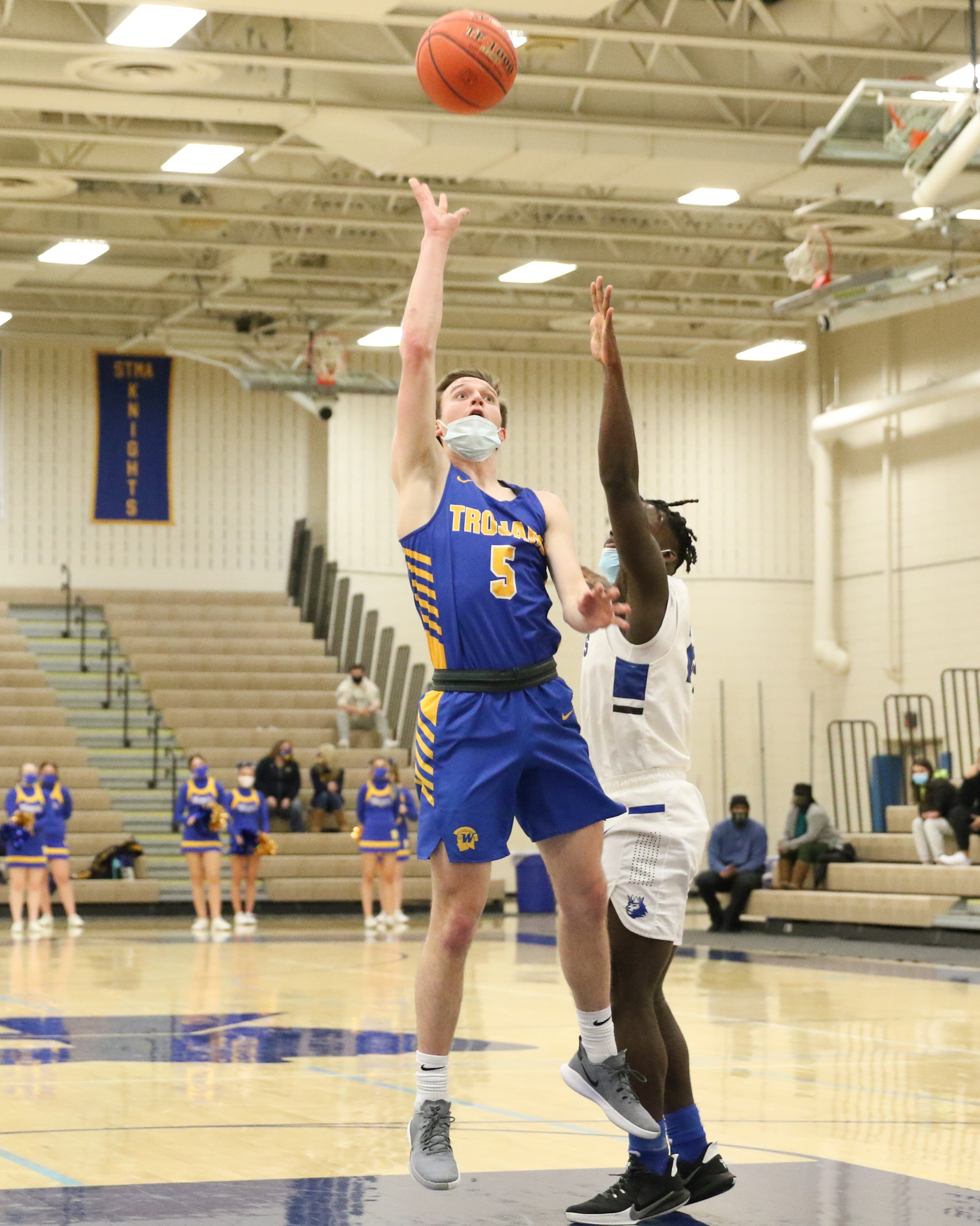 Wayzata's Eddie Beeninga (5) watches his one-handed put back against Hopkins Friday night. Beeninga finished with 13 points in the Trojans' 68-60 Lake Conference victory over the Royals in Wayzata. Photo by Jeff Lawler, SportsEngine