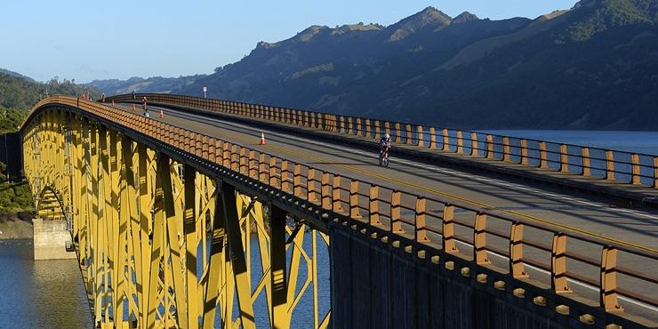 IRONMAN Bikers on a bridge