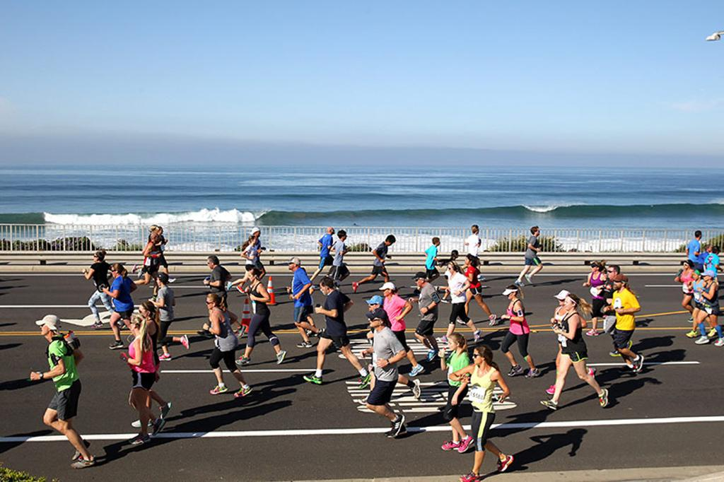 Runners in front of ocean
