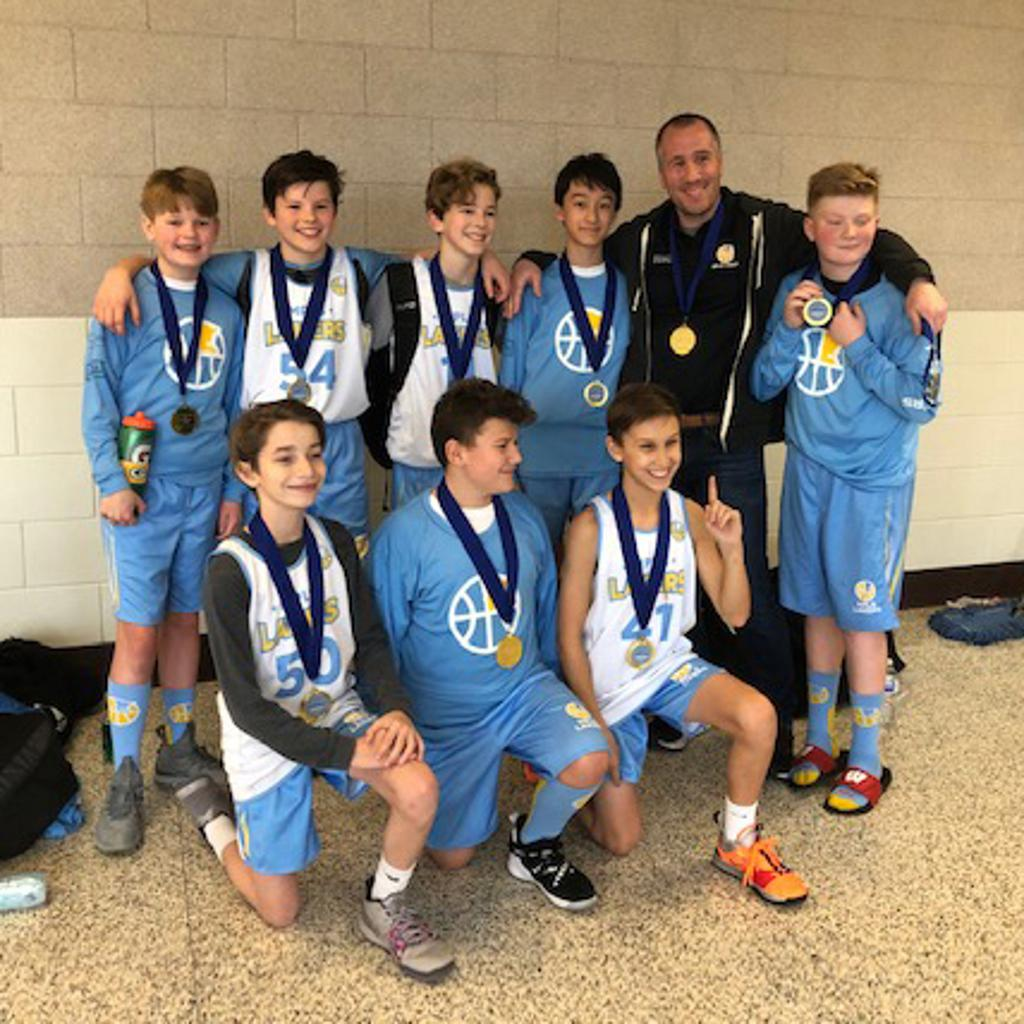 Minneapolis Lakers Boys 7th Grade White pose with their Medals after becoming the Champions at the Tartan Tip Off tournament in Oakdale, MN