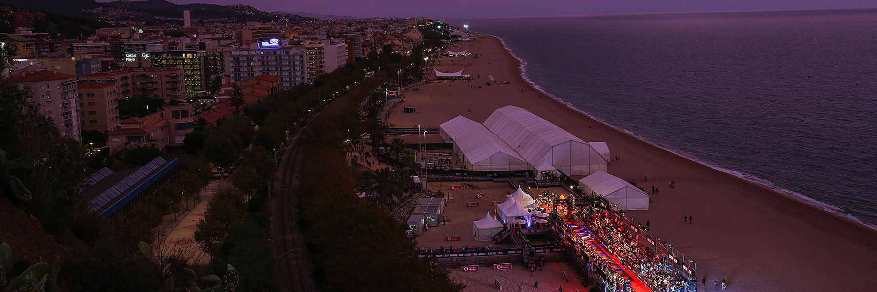 Bird's eye view of the IRONMAN Barcelona magic finish line at the beach of Calella in the morning hour