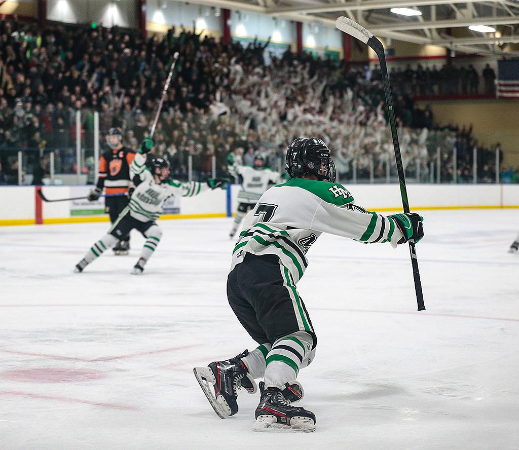 Hill-Murray's Nick Pierre (7) celebrates his game-winning goal. Pierre's third-period goal gave the Pioneers a 3-2 win over White Bear Lake in the Class 2A, Section 4 final. Photo by Cheryl A. Myers, SportsEngine