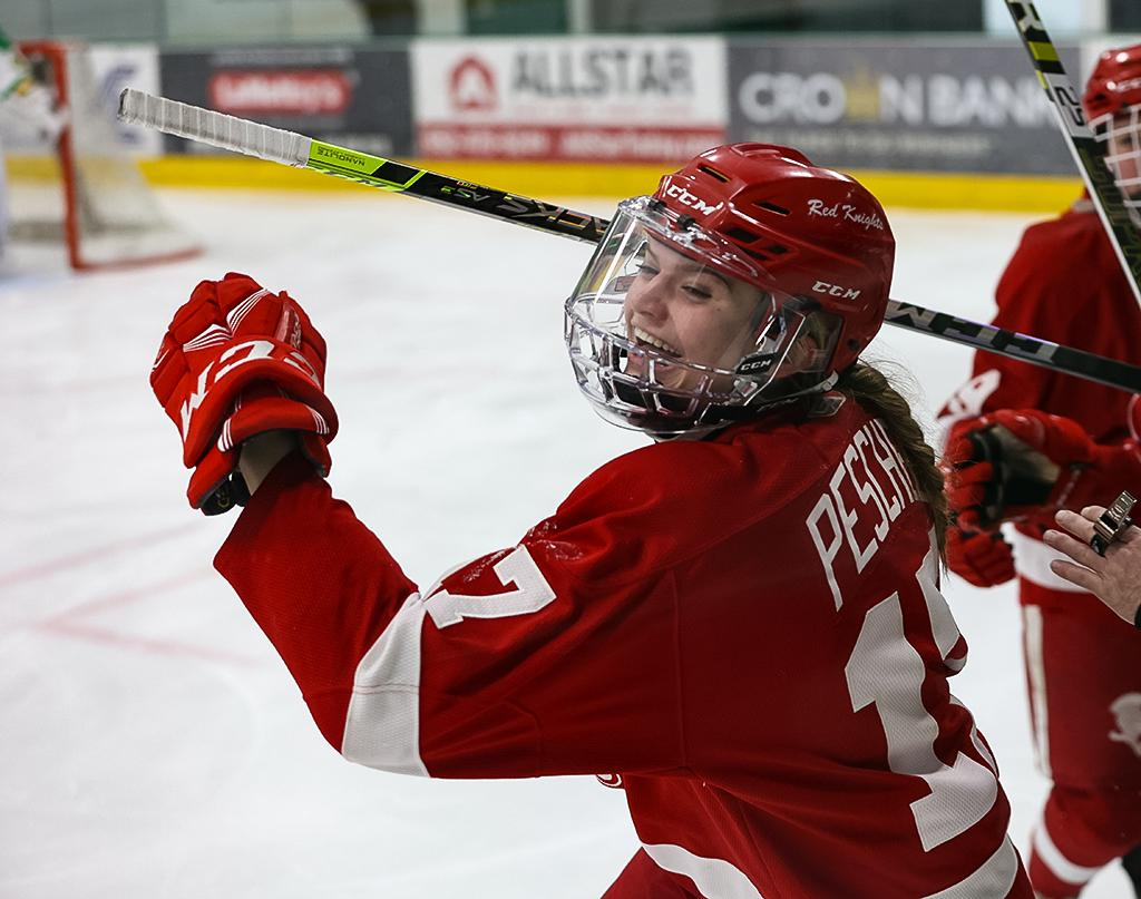 The Red Knights' Emma Peschel heads to the bench in celebration. Peschels' second-period goal gave Benilde-St. Margaret's a 1-0 lead over the Hornets. Photo by Cheryl A. Myers, SportsEngine