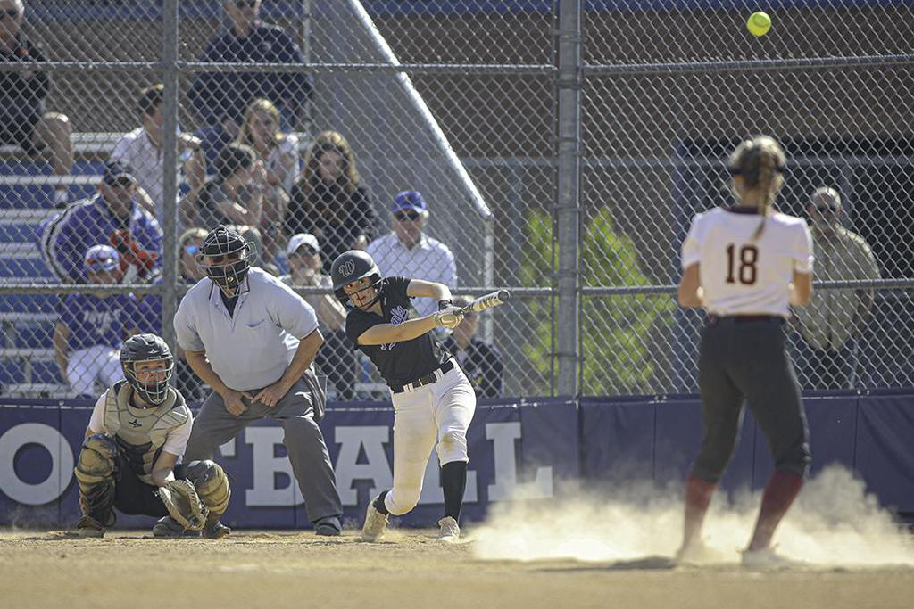 Woodbury's cleanup hitter, Kam Monson, watches her two-run home run in the first inning. Photo by Mark Hvidsten, SportsEngine
