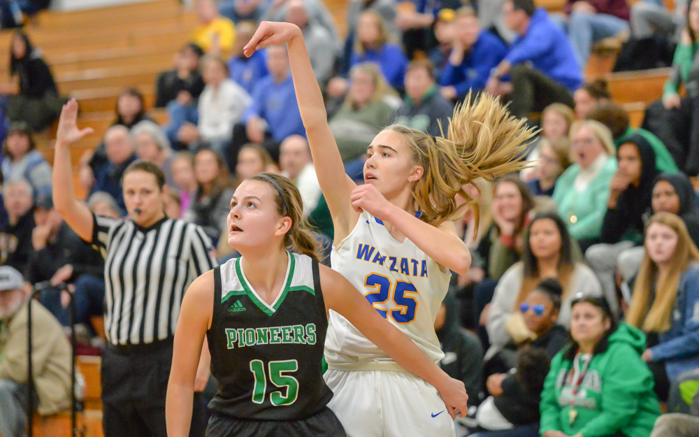 The Trojans' Mara Braun (25) sinks a three-pointer in the first half. The Trojans went on to beat the Pioneers 67-42. Photo by Earl J. Ebensteiner, SportsEngine