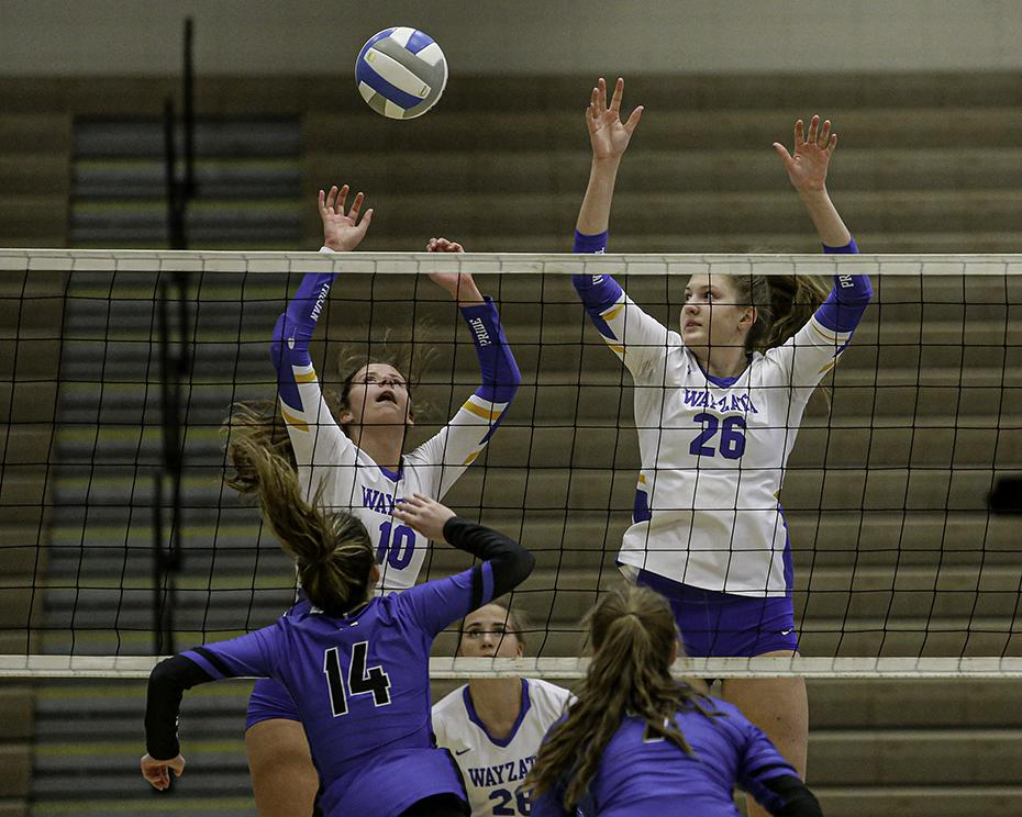 Wayzata's Stella Swenson (10) and Emma Goerger (26) come down after blocking a shot by Minnetonka's Morgan Rooney in the Trojans' five-set victory. Photo by Mark Hvidsten, SportsEngine