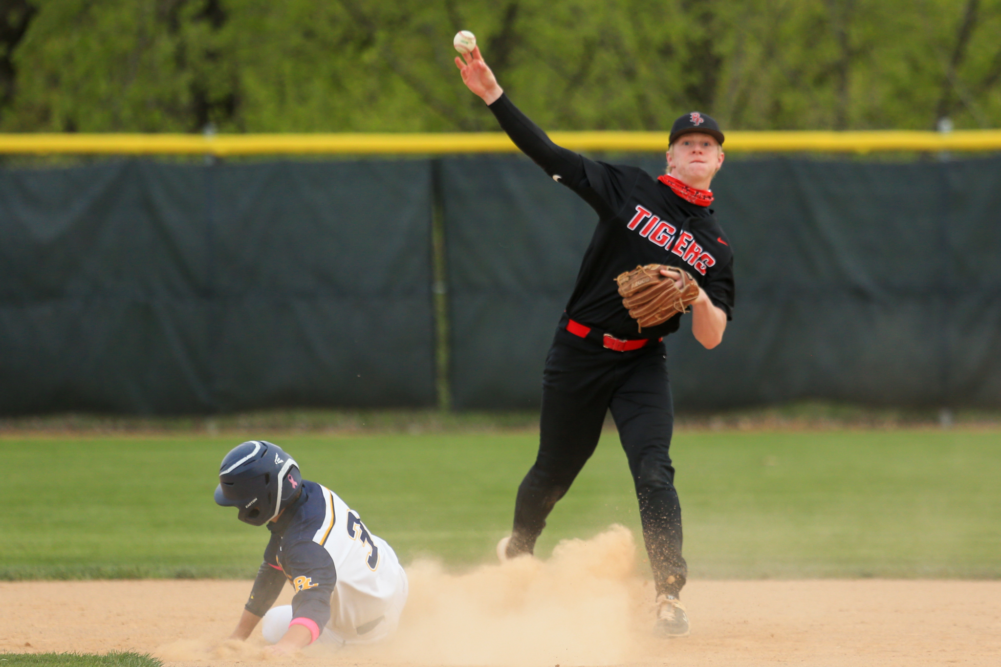 Belle Plaine second baseman Jackson Kruger turns to make the throw to first base on a successful double play against Prior Lake. The Tigers fell to the Lakers 9-2 Saturday evening at Memorial Park in Prior Lake. Photo by Jeff Lawler, SportsEngine