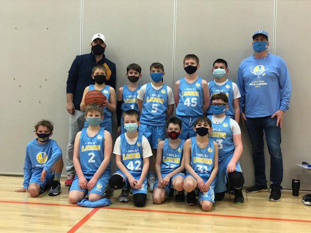 Mpls Lakers Youth Traveling Basketball Program Inc Boys 5th Grade Blue pose after winning the Consolation Bracket at MYAS Grade State year end tournament