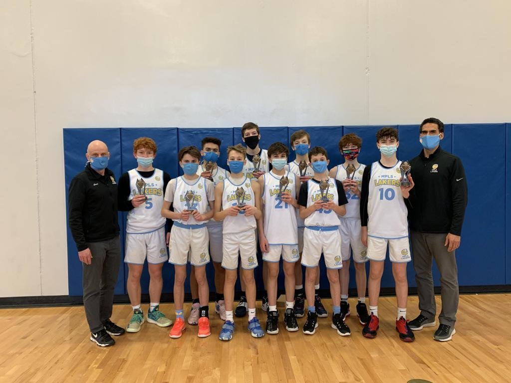 Mpls Lakers Youth Traveling Basketball Program Inc Boys 8th Grade Gold pose after becoming the Champions at the Hopkins Royal Rumble. in Hopkins, MN