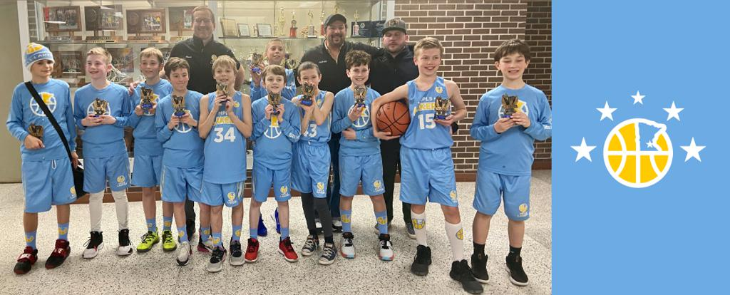 Mpls Lakers Youth Traveling Basketball Program Inc Boys 5th Grade White pose with their Trophies after becoming the Champions at the Park Center Winter Shootout tournament in St Paul, MN