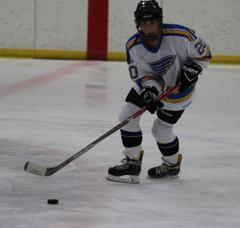 Ice Wolves forward Jamie Prendergast carries the puck