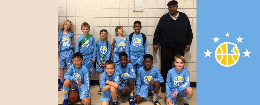 Minneapolis Lakers Boys 4th Grade White pose with their Medals after becoming the Champions at the Bloomington Lions Invitational tournament in Bloomington, MN