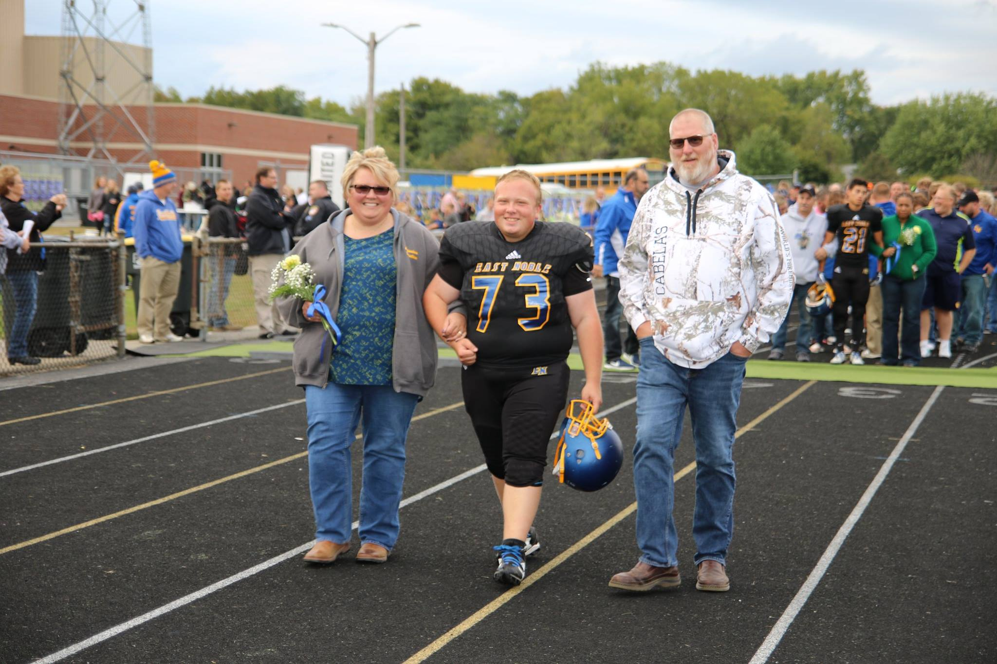 Collin Double with his parents on East Noble's Senior Night (courtesy Terry Lewis)