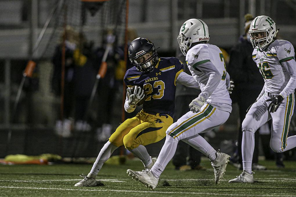 Prior Lake sophomore Joseph Krouse was slowed and tackled by Edina's Anthony Doll. The run set up a Lakers touchdown in the first half. Photo by Mark Hvidsten, SportsEngine